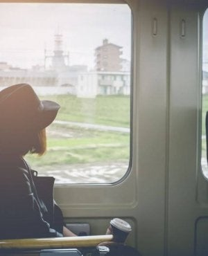 Girl on a train thinking about changing habits.