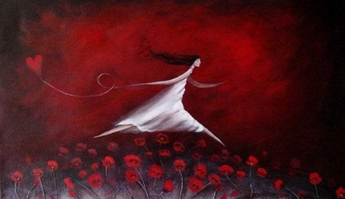 A girl is running through red flowers with a heart on a string.