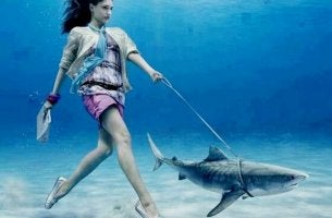 girl walking a pet shark