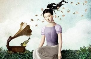 A girl with flowers that are coming out of a horn.