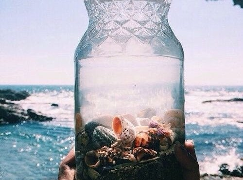 A jar is full of seashells.