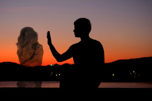 man reaching for silhouette of a woman