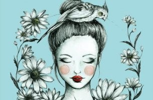 A pretty woman has a bird on her head.