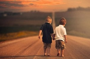 two little boys walking hand in hand