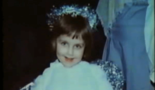Beth Thomas as a little girl in a dress.