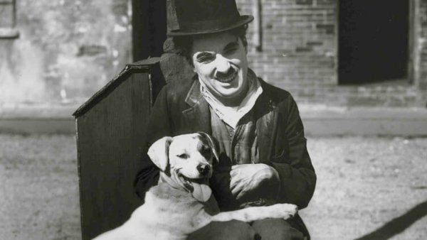 Charlie Chaplin with a dog