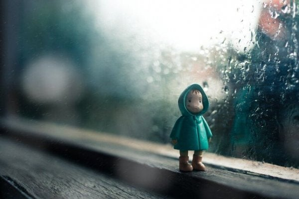 a doll of a child wearing a raincoat