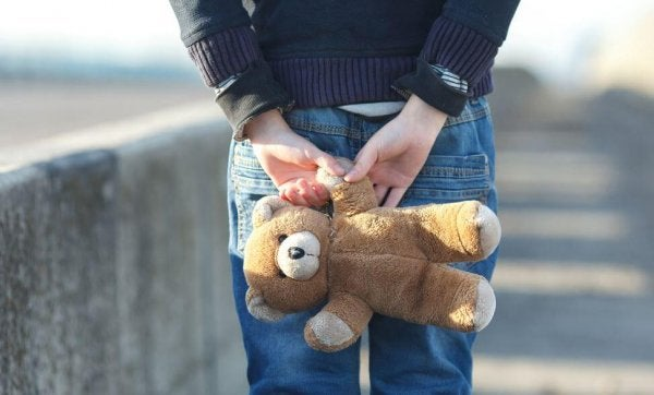 a victim of child abuse holding a teddy bear