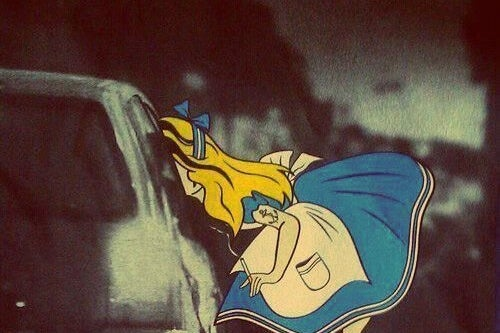 Alice in Wonderland smoking with a tattoo.