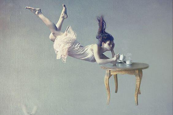 A fantastical scene of a woman falling with tea.