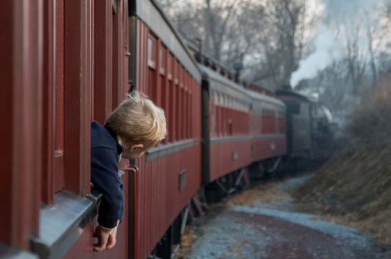 A little boy on a train.
