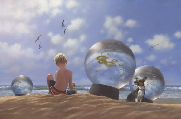 a little boy playing on the beach with a dog and fish in a snowglobe