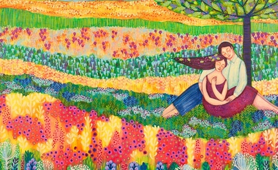 a happy couple in a colorful field of flowers