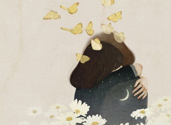 A couple hugging with butterflies flying out of them.