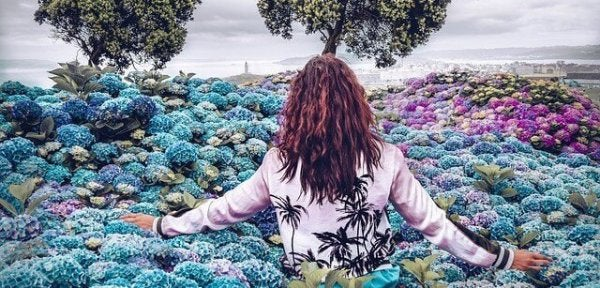 a woman in a field of flowers