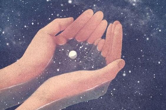 hands holding outer space