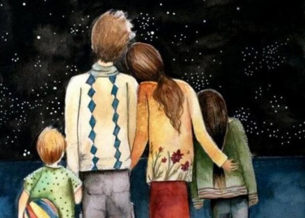 parents and children embracing while looking at the night sky