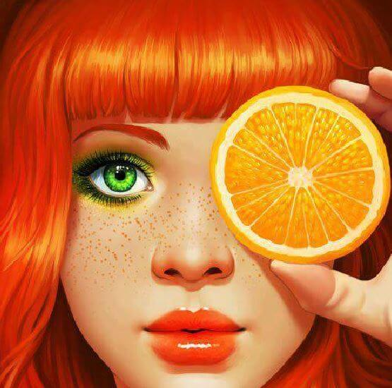 a girl with orange hair and green eyes puts an orange to her eye