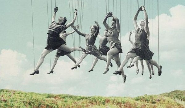 Puppet people leaping in a field.