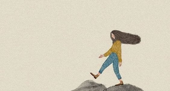 a girl walking on the mountaintop