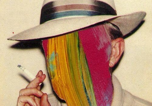 a man in a hat smoking with a colorful painted face