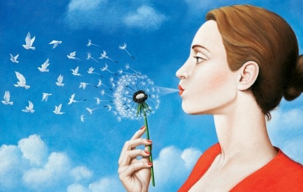 a woman blowing a dandelion that turns into birds