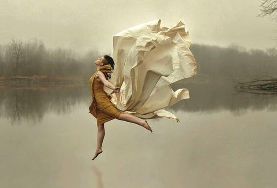 a woman dancing freely on a lake