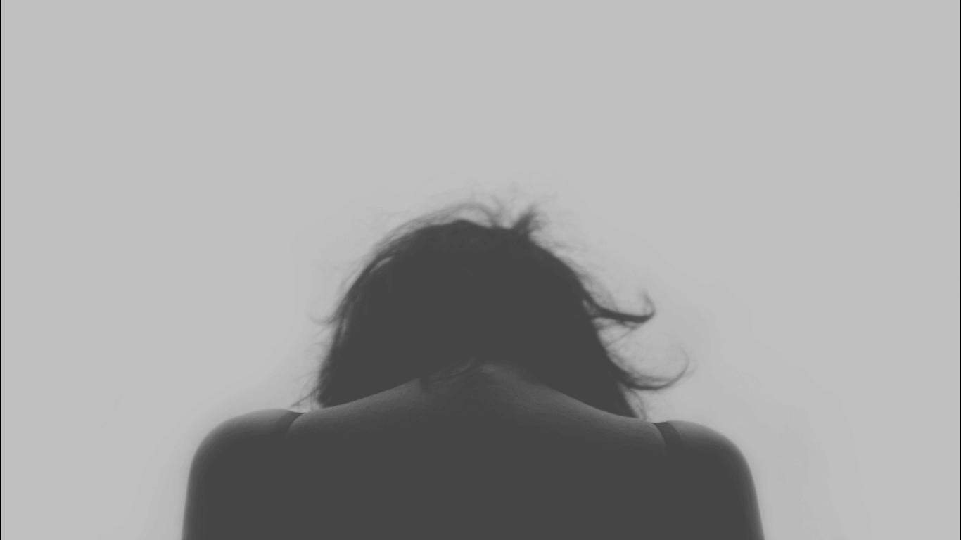 a woman, head down