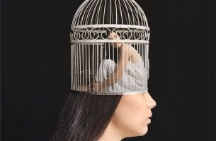 A woman is trapped inside a birdcage inside her mind.