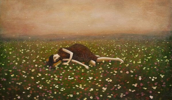 a woman lying in a field of flowers