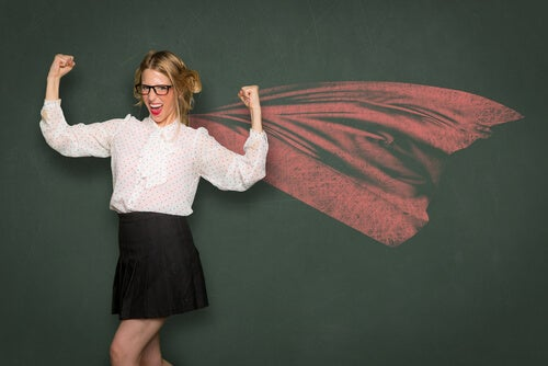 woman with a growth mindset, wearing glasses and a cape like superman