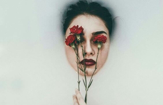 a woman with roses on her eyes
