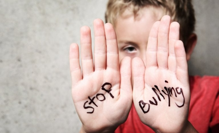 Boy with Stop Bullying written on his palms.