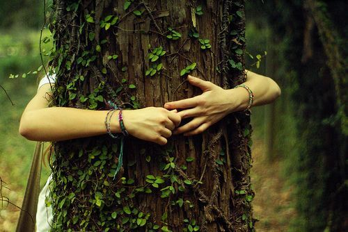 A girl hugging a tree in gratitude