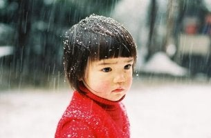 An Asian little girl is sad.