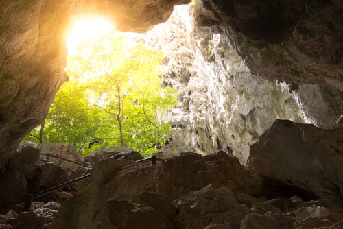 a cave with light shining in