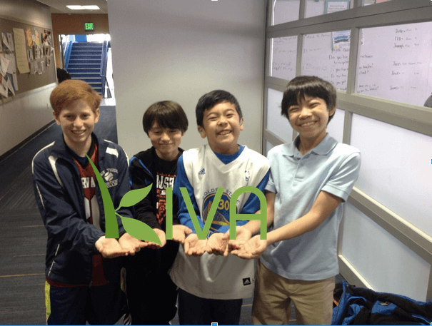 Four boys advertising Kiva method.