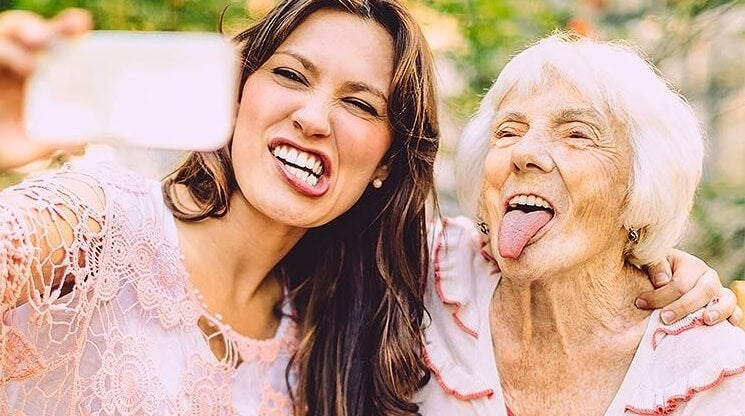 an older woman and a young woman taking a selfie