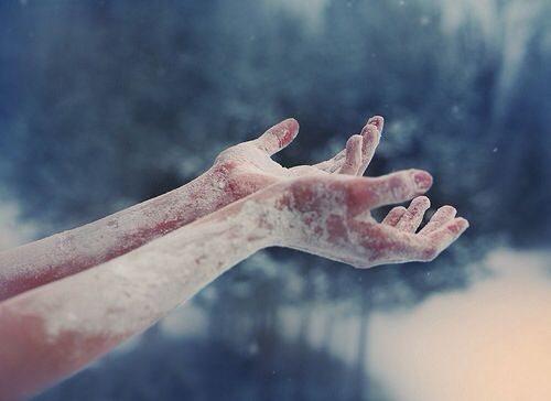 frozen hands reaching out from a heart of ice