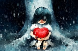 girl holding heart in the rain
