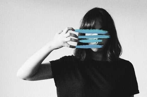 a woman with her face covered up by blue lines