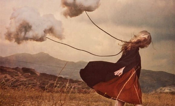 a girl carrying dark clouds