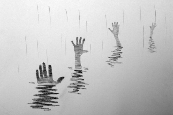 drowning hands in the water