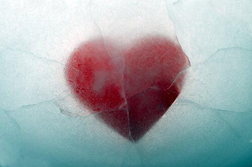 A heart is frozen in the water.