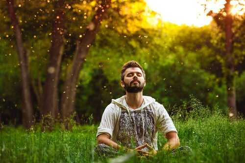 man meditating in a field