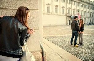 Jealous girl spying on boyfriend
