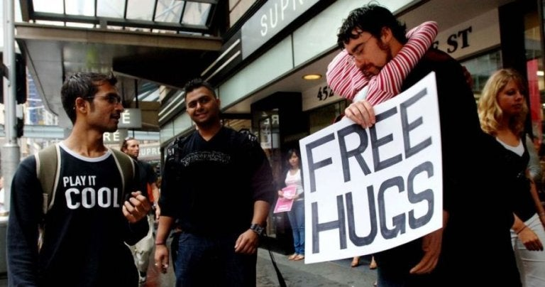 Juan Mann giving  out free hugs