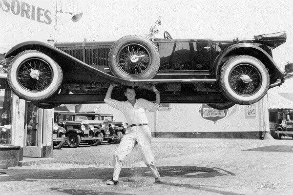 a man lifting a car