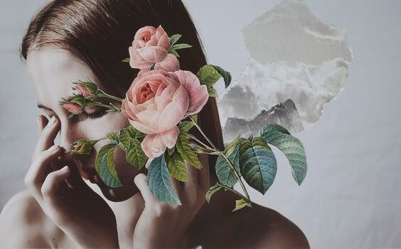 A woman's face covered by flowers.