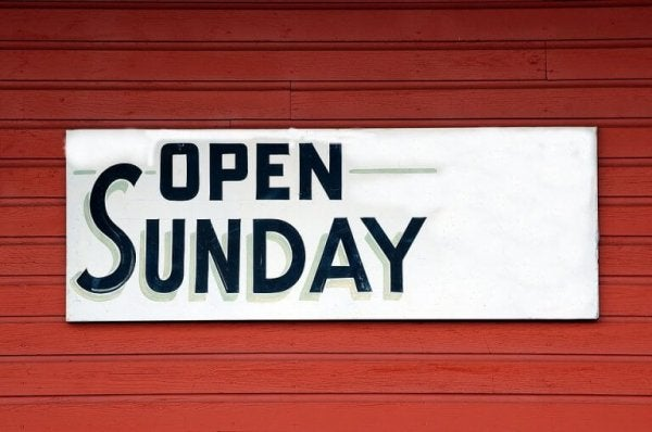 "Sign saying ""open Sunday"""